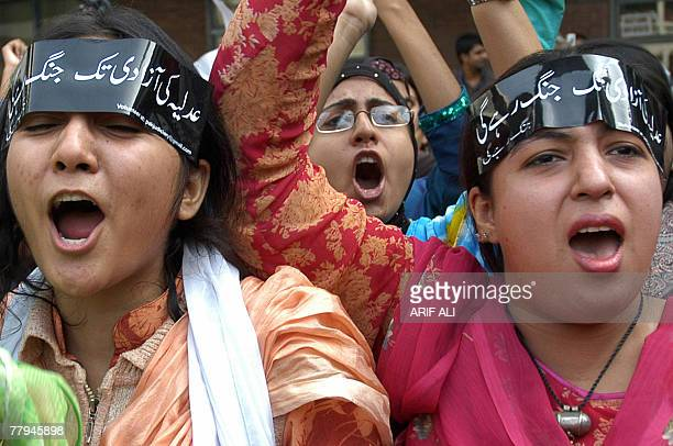Pakistani university students shout slogans to protest the detention of cricketer-turned politician Imran Khan during a protest rally in Lahore, 16...