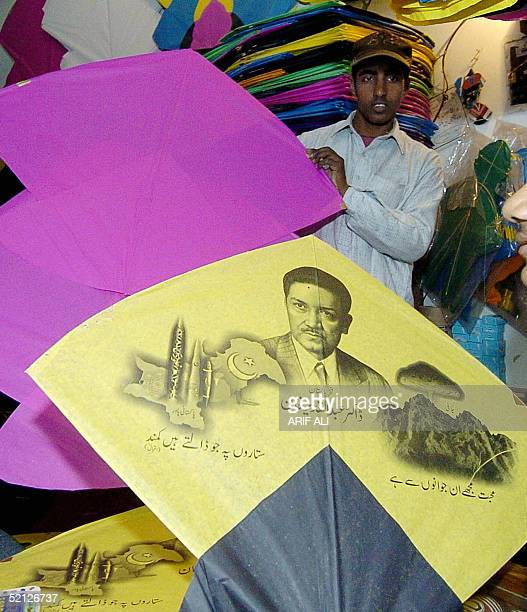 Pakistani vendor displays kites one adorned with a picture of the father of the Pakistani nuclear bomb Abdul Qadeer Khan at his shop in Lahore 03...