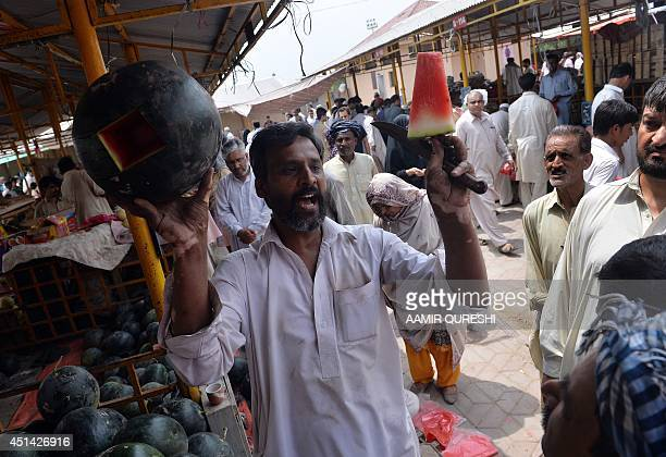 A Pakistani vendor sells watermelon at a weekly bazaar ahead of the Islamic holy month of Ramadan in Islamabad on June 29 2014 Islam's holy month of...