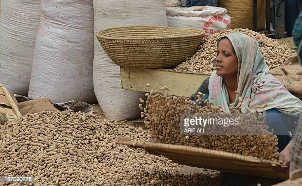 A Pakistani vendor separates peanuts at a market in Lahore on November 6 2013 An International Monetary Fund team is visiting Pakistan to monitor...