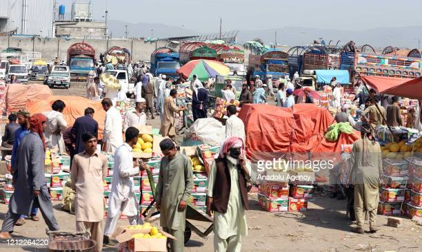 Pakistani vendors purchase seasonal fruits at the main fruit and vegetables market during the Muslim's holy month of Ramadan as Pakistan gradually...