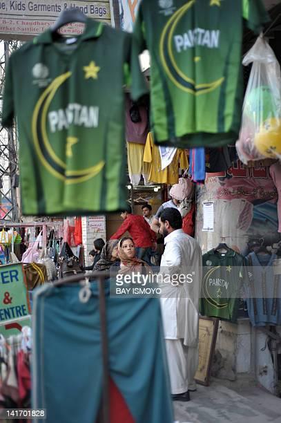 Pakistani vendors sell cricket team jerseys in Rawalpindi on March 22 2012 during the final match between Pakistan and Bangladesh Hosts Bangladesh...