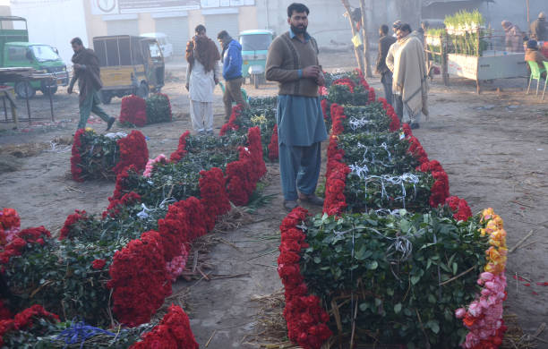 Pakistani vendors selling flowers at Flower Market as the demands of flowers high ahead of Valentine`s Day Vendors selling valentines gift on the eve.