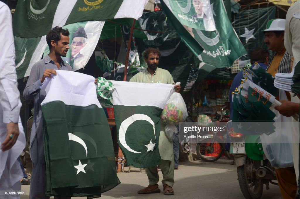 Pakistani vendors selling national flags in the run up to Independence Day in Lahore The annual celebration is every 14th of August The country...