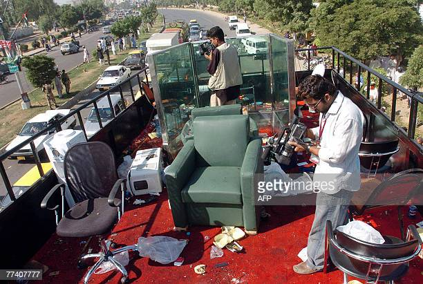 Pakistani video reporters capture images of the platform of the bullet proof truck which was carrying former Pakistani prime minister Benazir Bhutto...