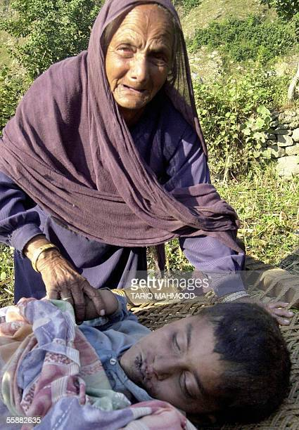 Pakistani villager Sardar Mai mourns over the dead body of her grandson Imran in the earthquake worst hit village of Balakot in Pakistan's North West...