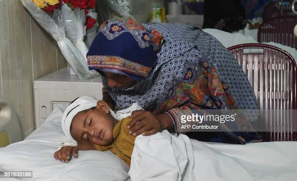 A Pakistani villager woman tends her son who was wounded in crossborder shelling by Indian Border Security Force at a military hospital in Sialkot in...