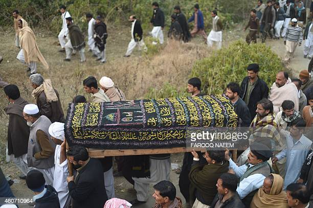 Pakistani villagers carry the coffin of army commando Arshad Mehmood who was convicted for his involvement in a 2003 assassination attempt on former...