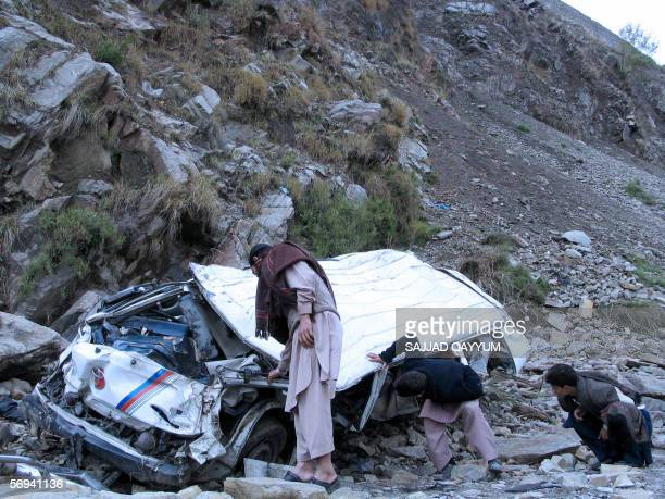 Pakistani villagers examine the wreckage of a minibus after an accident in Balakot some 150 kilometers northeast of Peshawar 26 February 2006 Fifteen...