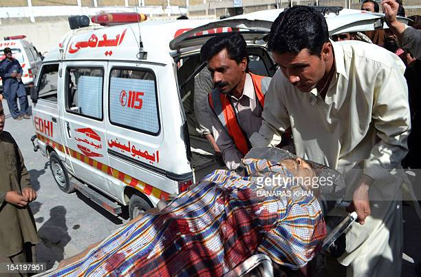 Pakistani volunteers carry a gunshot victim on a stretcher at a hospital following an attack by gunmen in Quetta on October 16 2012 Gunmen shot dead...