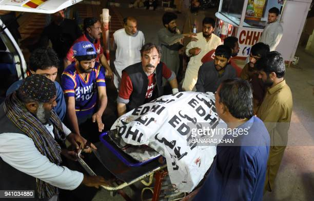 Pakistani volunteers move the body of a Christian resident killed in an attack by gunmen to a hospital in Quetta on April 2 2018 Four Christians were...