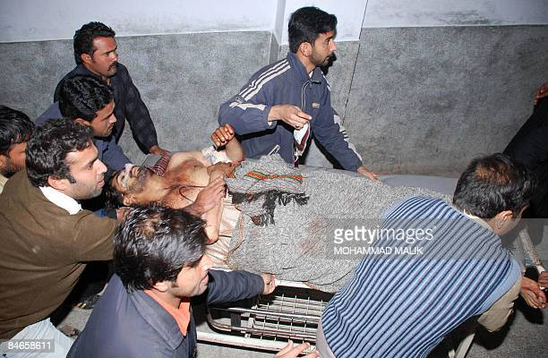 Pakistani volunteers push a stretcher carrying an injured suicide attack victim at a hospital in Multan on February 5 2009 At least 21 people were...