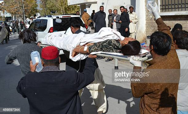 Pakistani volunteers shift an injured polio female health worker at a hospital in Quetta on November 26 2014 Gunmen opened fire on a team of polio...