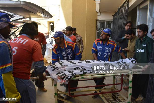 Pakistani volunteers transport the body of a polio worker from a hospital following an attack by gunmen in Quetta on January 18 2018 A mother and...