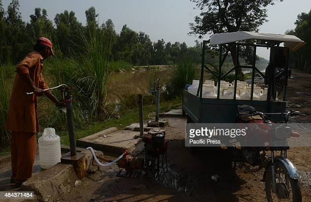 Pakistani water suppliers are collecting water from the canal near Lahore before supplying them to the citizens Due to the excessive use of aquifer...