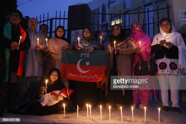 Pakistani wellwishers take part in a vigil for the victims of a suicide attack on a church in Quetta on December 19 2017 A suicide bomb attack on a...