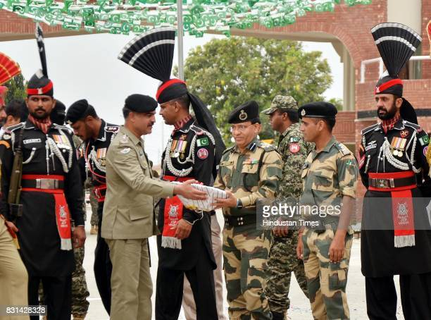 Pakistani Wing Commander Bilal present sweets to Indian Border Security Force Commandant Sudeep during a ceremony to celebrate Pakistanis...