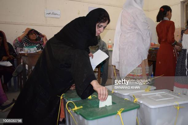 A Pakistani woman casts her vote at a polling station during Pakistan's general election in Quetta on July 25 2018 Pakistanis voted July 25 in...