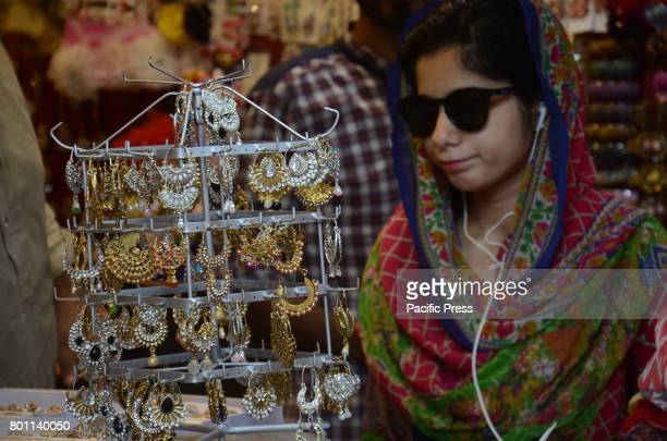 Pakistani woman eid shopping at Anarkali Bazaar during her Eid al Fitr shopping on 'Chand Raat' in Lahore EidulFitr is an important religious...