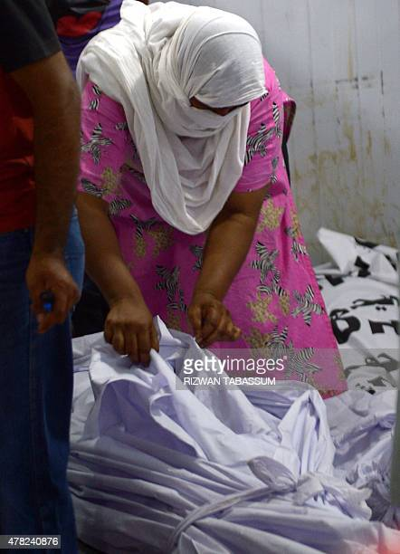 A Pakistani woman tries to identify the body of a heatstroke victim at a cold storage of the Edhi morgue in Karachi on June 24 2015 A deadly heatwave...