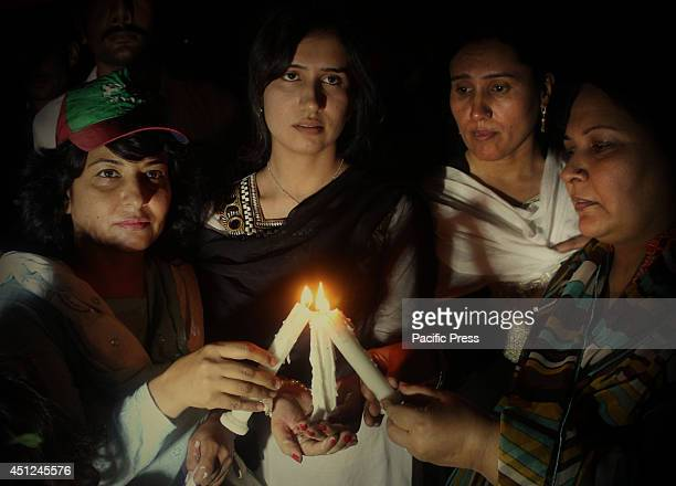 Pakistani women activists light candles for the victims of torture in Lahore during the eve of International Day in Support of the Victims of Torture.
