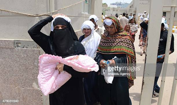 Pakistani women cover their heads with wet towels to avoid heatstroke during a heatwave in Karachi Pakistan June 30 2015 A Pakistani official says...