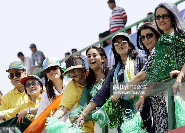 Pakistani women cricket fans are joined by one Indian fan while cheering for their team during the final one day international match between India...