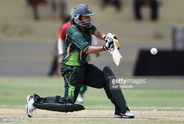 Pakistani women cricket team captain Sana Mir plays a shot during the first women's One Day International cricket match between Pakistan and...