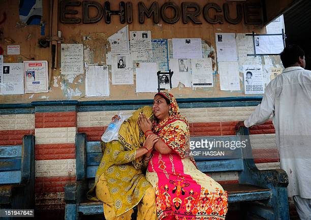 Pakistani women grieve as they wait at the EDHI Morgue to identify their relatives who died in a garment factory fire in Karachi on September 13 2012...