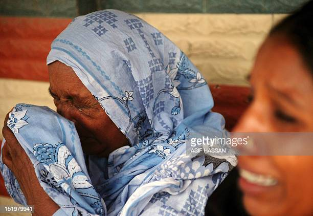 Pakistani women grieve as they wait at the EDHI Morgue to identify their relatives who died in a garment factory fire in Karachi on September 14 2012...