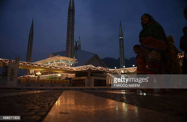 Pakistani women leave during Laylat alQadr or the 'Night of Power' the night when the first verses of the Quran were revealed at the Faisal Mosque in...