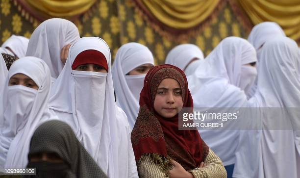 Pakistani women supporters of an Islamic and political JamaateIslami party gather during a protest rally to mark the Kashmir Solidarity Day in...