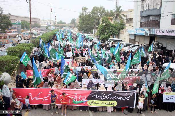 Pakistani women supporters of Islamic party JammateIslami stage a protest against the Indian government's decision to repeal Article 370 of the...