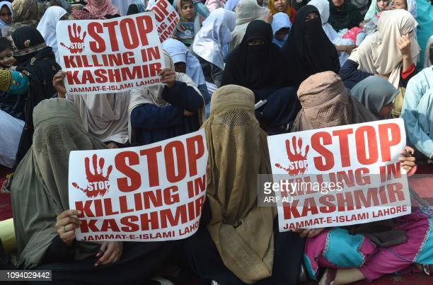 TOPSHOT Pakistani women supporters of the JamaateIslami party hold placards as they march during a protest rally to mark Kashmir Solidarity Day in...