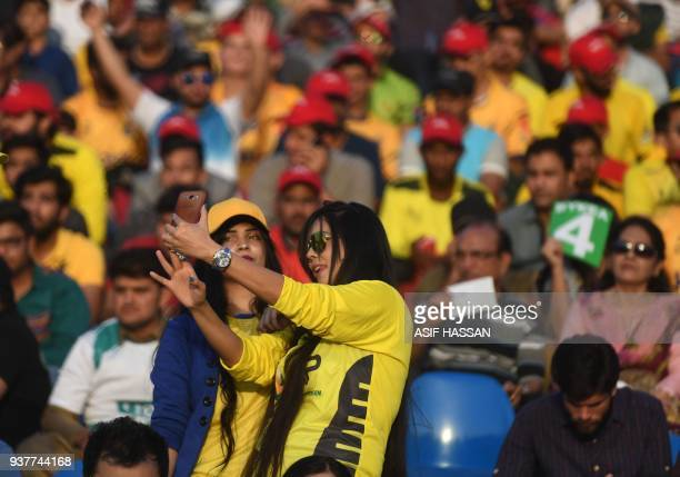 Pakistani women take selfie at the National Cricket Stadium during the Pakistan Super League final match between Peshawar Zalmi and Islamabad United...