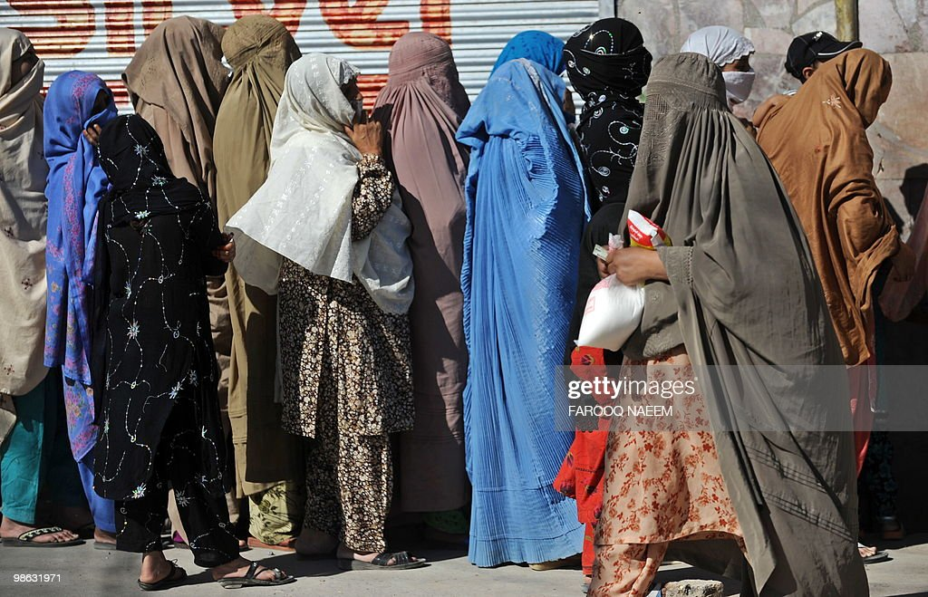 Pakistani women wait in line for sugar outside a utility store in Rawalpindi on April 23, 2010. Pakistan is Asia�s third-largest user of sugar and the world's fifth largest producer of sugar cane, according to the Pakistan Sugar Mills Assocation. AFP PHOTO/Farooq NAEEM