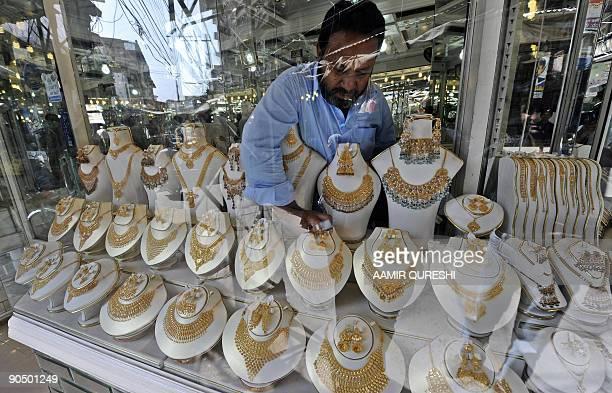 A Pakistani worker adjusts jewellery on display at his gold workshop in Rawalpindi on September 9 2009 Gold prices in Pakistan on September 9 touched...