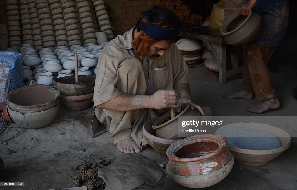 Pakistani Worker Busy In Preparing Clay To Make Different