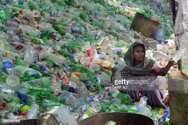 Pakistani worker sorts out plastic bottles at a warehouse in Lahore on May 10 2018