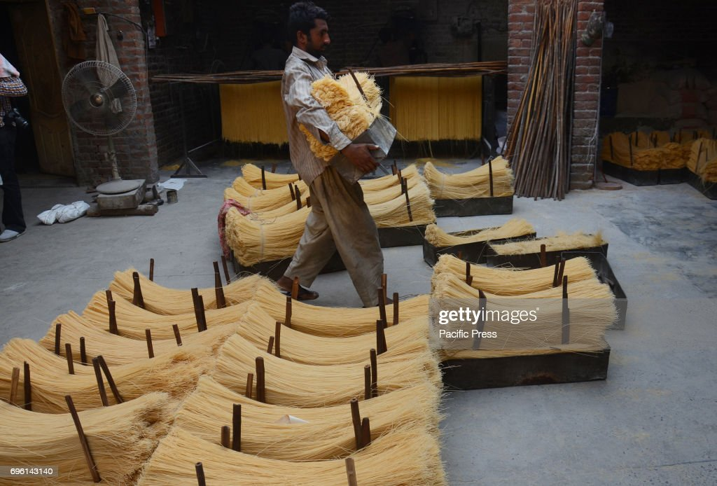 Pakistani worker spreading the thin vermicelli for drying at a factory in the holy fasting month of Ramzan purpose prepared for the upcoming Eidul...