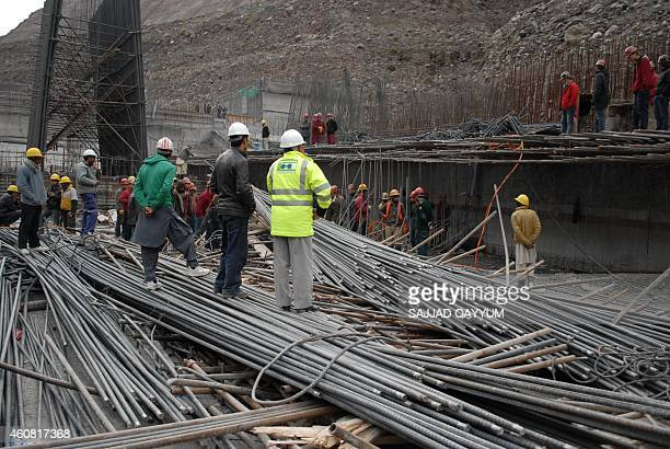 Pakistani workers and Chinese engineers search the site after an accident at the NeelumJhelum Hydropower project intake site some 40 kilometres north...