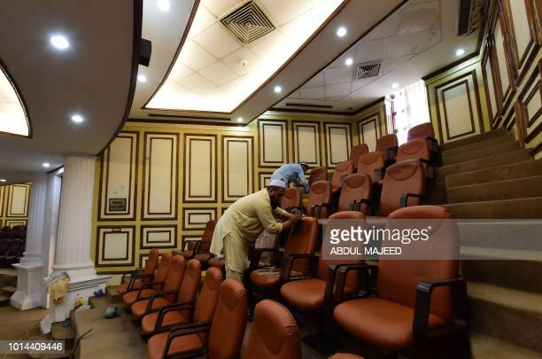 Pakistani workers clean the provincial assembly hall in Peshawar on August 10 ahead of the first session after the general election Pakistani...