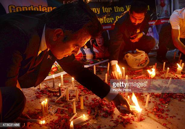 Pakistani workers of lawyers strategic council and civil society holds a candlelight vigil for the victims of Naltar M1-17 helicopter crash in Gilgit...