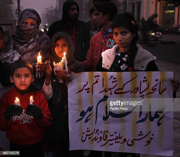 Pakistani workers of political party Pakistan tehreek insaf women wing Pakistan muslim league women wing Social Societies students hold up candles to...