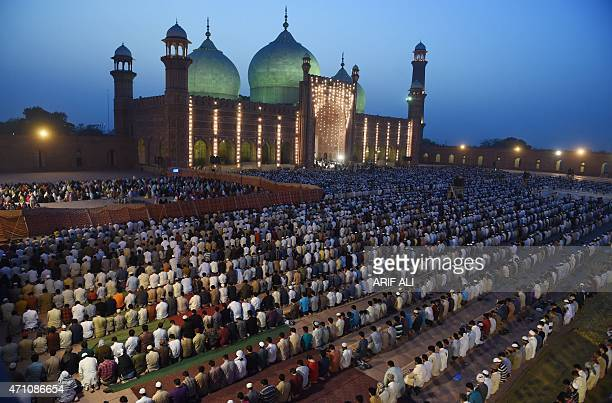 Pakistani worshippers offer evening prayers at the historical Badshahi mosque in Lahore on April 25 led by the Saudi Arabian Imam of the Grand Mosque...