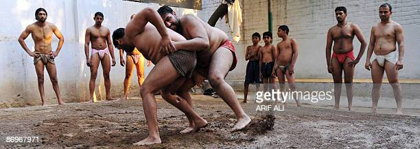 Pakistani wrestlers train at an Akhra an institute of local wrestlers in Lahore on May 11 2009 The wrestlers known as pehalwans are among the few who...