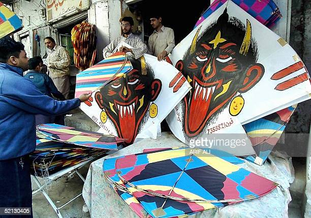 Pakistani youth checks kites before purchasing one from a stall in Lahore 04 February 2005 on the eve of Basant festival or festival of kites...