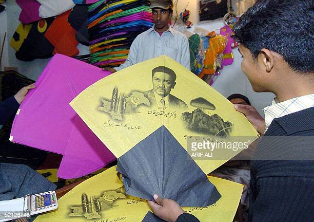 Pakistani youth looks at a kite adorned with a picture of Abdul Qadeer Khan the father of the Pakistani nuclear bomb at a shop in Lahore 03 February...