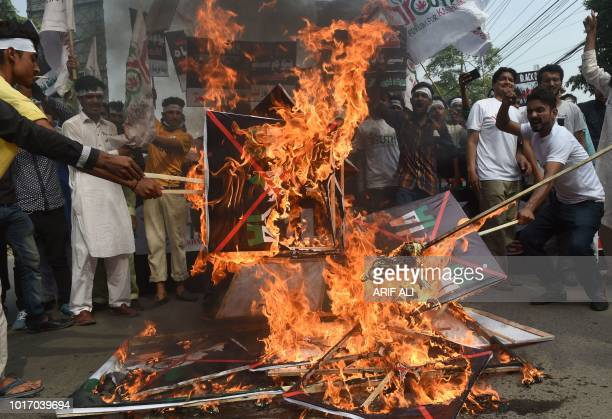Pakistani youths burn Indian flags in a rally in Lahore on August 15 as they observe 'Black Day' on the Indian Independence Day Pakistani protestors...