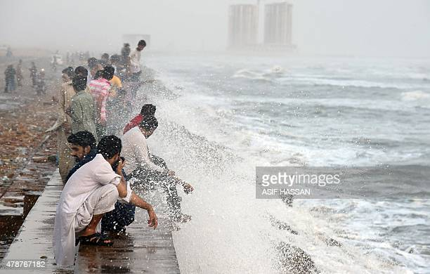 Pakistani youths cool themselve at the Clifton beach during heatwave in Karachi on June 27 2015 More than 1000 people have died as a result of days...